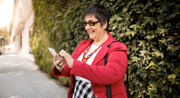 Senior woman using her smartphone and smiling