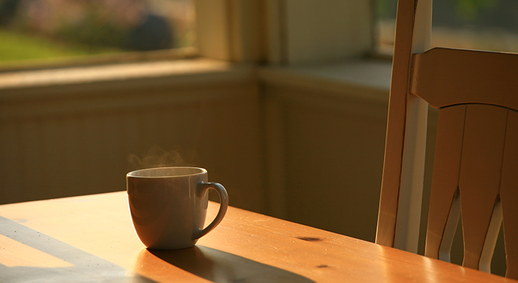 Steaming Morning Coffee on Porch Table
